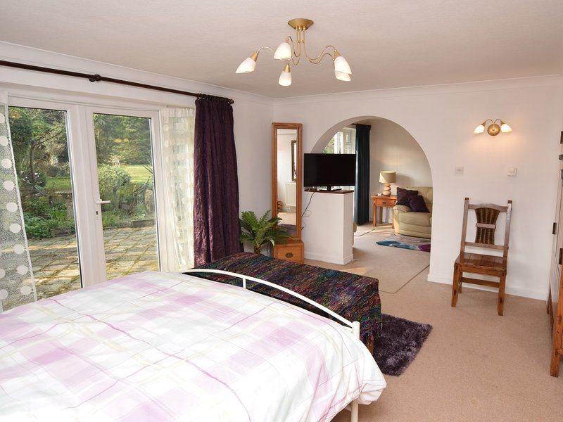 Double bedroom with archway to the lounge