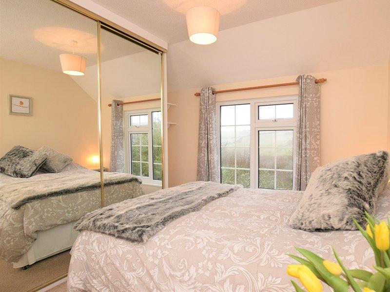 Double bedroom with views over garden