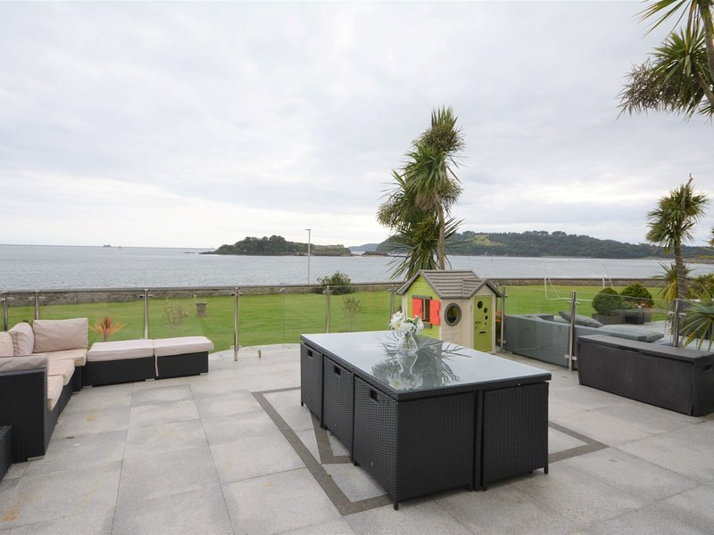 Relax on the patio area and enjoy the uninterrupted sea views