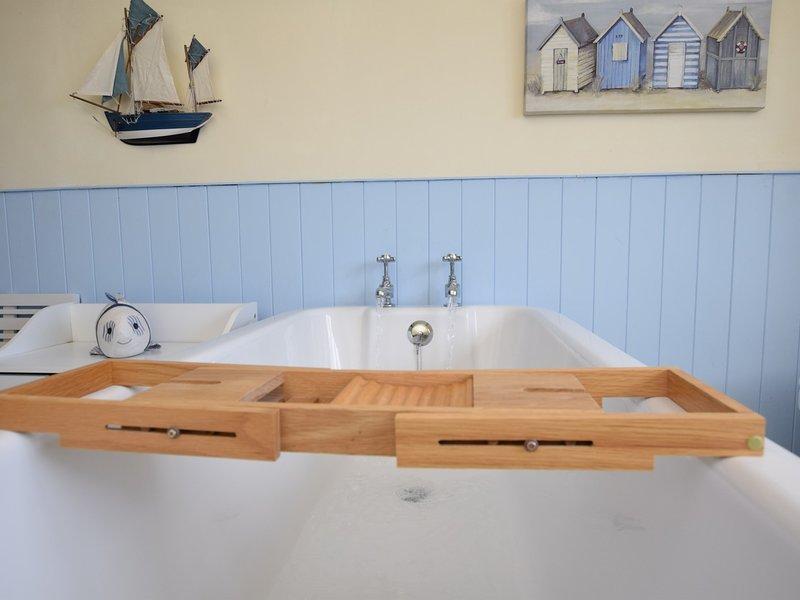 Enjoy a soak in the roll top bath