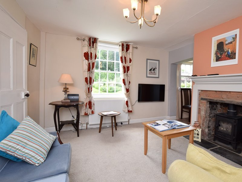 Cosy up in front of the gas wood burner in the lounge