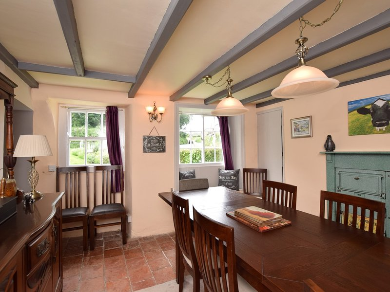 Beamed dining room full of charm and character