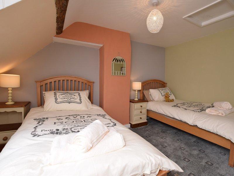 Second beamed twin bedroom