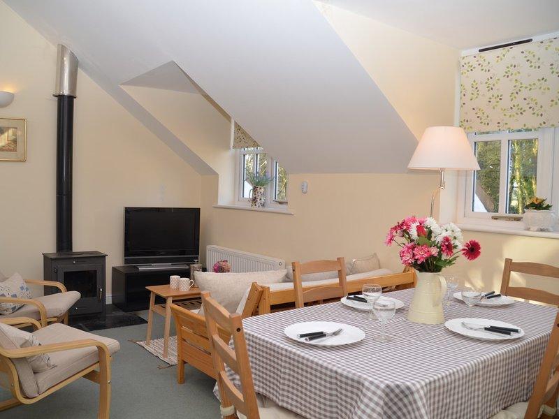 Open-plan lounge/kitchen/diner with wood burner for those cooler evenings