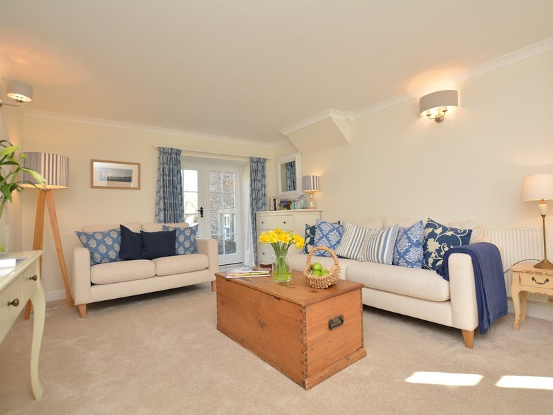 Beautiful stylish lounge with French door leading out to the enclosed rear garden