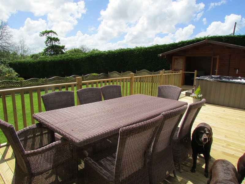 Outdoor decking with seating area and hot tub