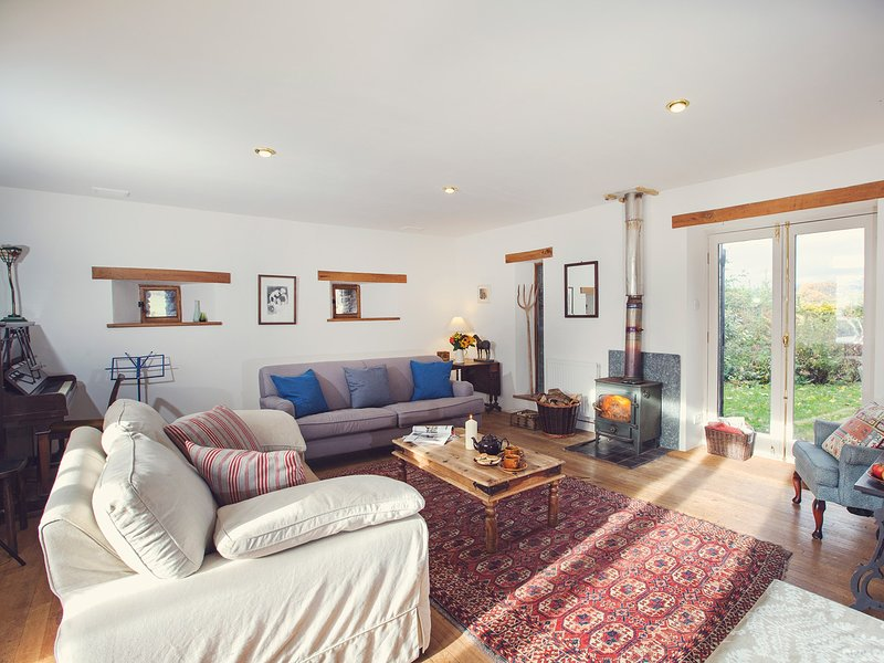 Open plan living with great views and a log burning stove