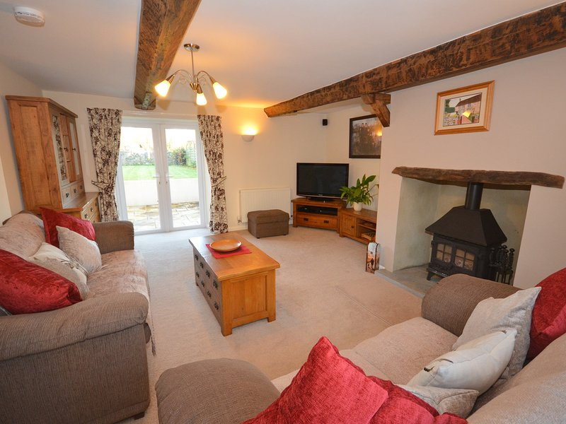 Lounge with woodburner and French doors leading to garden