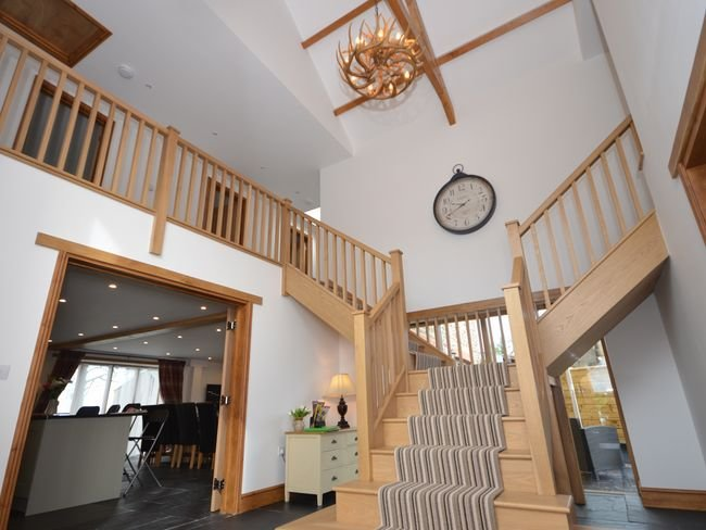 Stunning entrance hall with split staircase