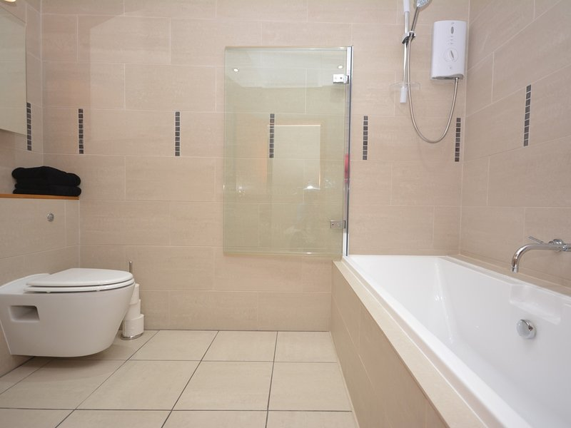 En-suite bathroom with shower over bath and WC