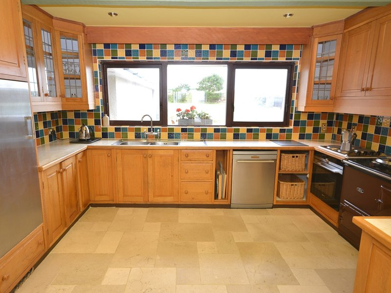 Large well-equipped kitchen with Aga making this a perfect coastal retreat any time of the year