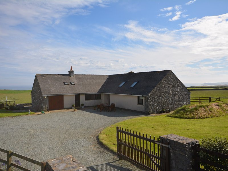 Large detached bungalow in enclosed grounds with unspoilt sea and island views