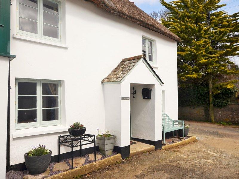 Pretty thatched cottage in quiet village