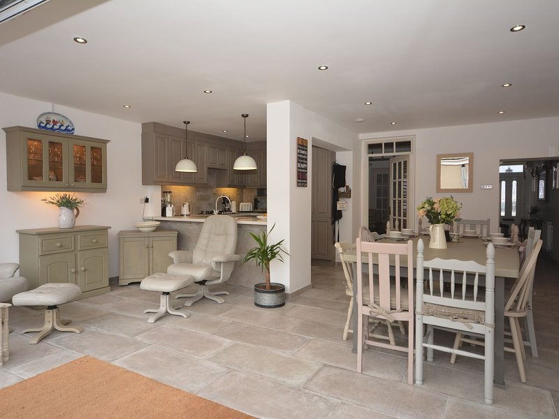 Enjoy the open plan kitchen and dining area