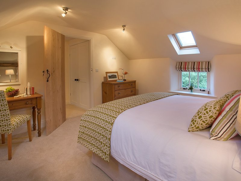 King-size bedroom with pretty features