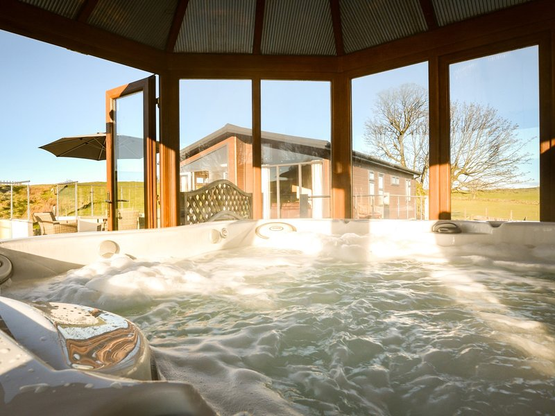 Relax and enjoy a dip in the private luxury housed hot tub
