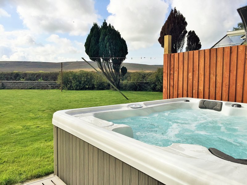 Relax and unwind in the hot tub and enjoy the views