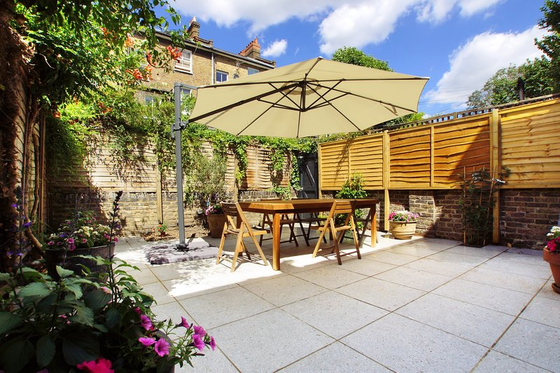 Sunny private garden, with large teak table and parasol to seat 8.