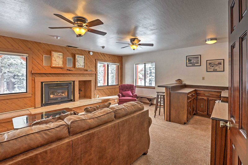 This home sleeps 14 with 2 living areas, 8 flat-screen TVs and 2 fireplaces.