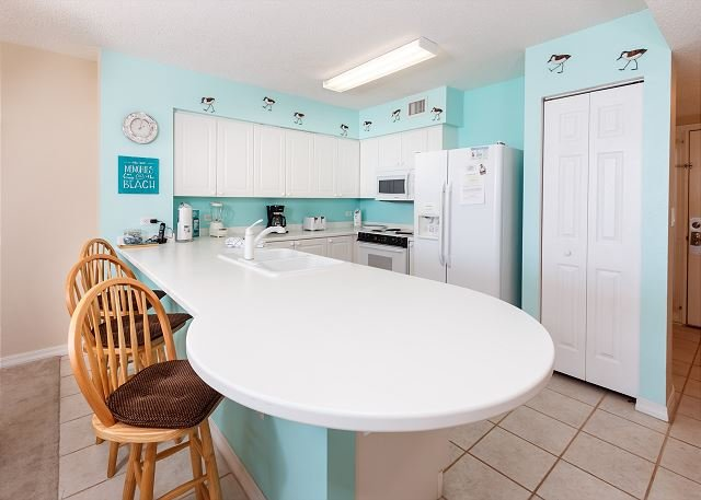 Beachy kitchen with fresh paint and lots of counter space