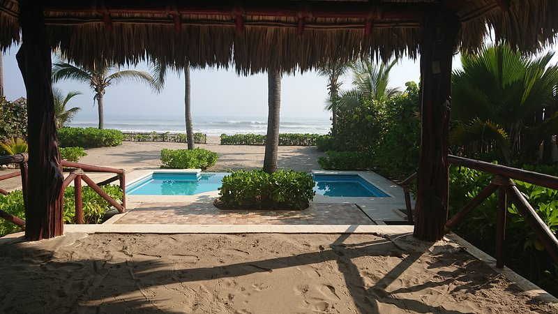 semi private beach palapa, exclusive pool for our guests.