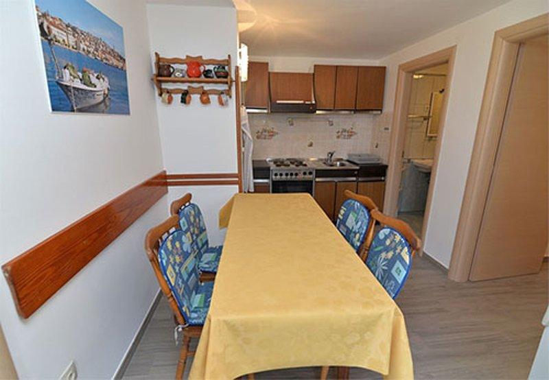 A2 Gardenia (4 + 1): cucina e sala da pranzo