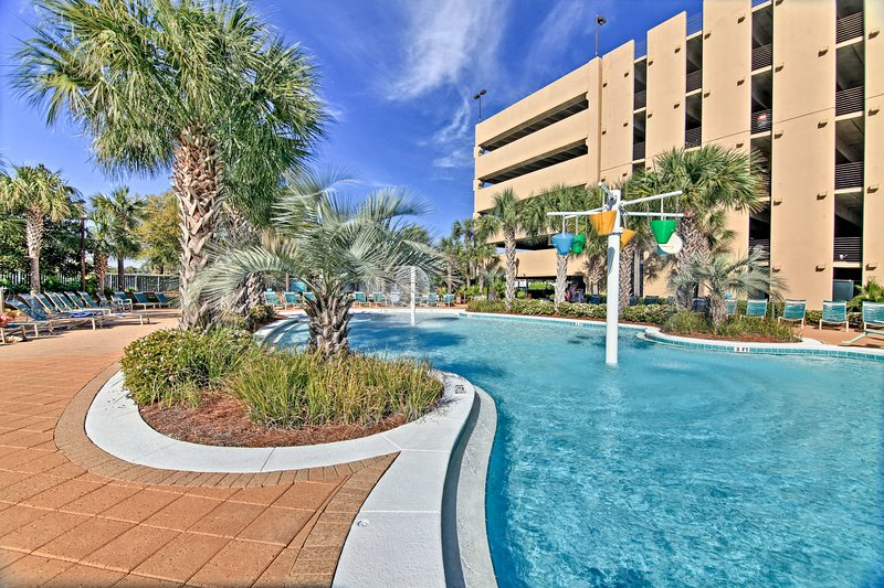 Located at the Emerald Beach Resort, this home has great community amenities.