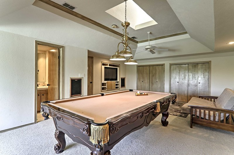 Play a friendly game of pool upstairs.