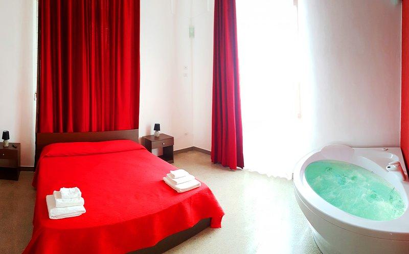 bedroom with jacuzzi room