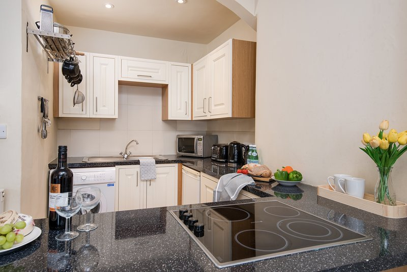 A fully fitted, high quality kitchen with ample storage and lots of appliances