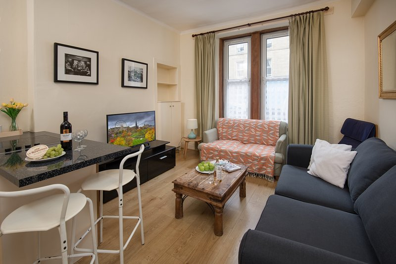 Spacious and light sitting room with ample seating and good quality furnishings