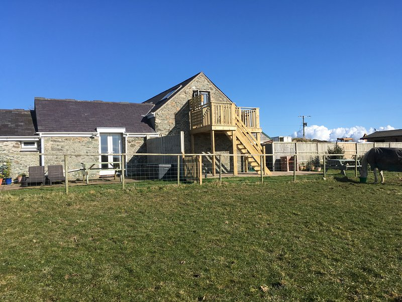 The granary (Ysgubor Hen) with balcony and Hen Llety our other letting property to the left
