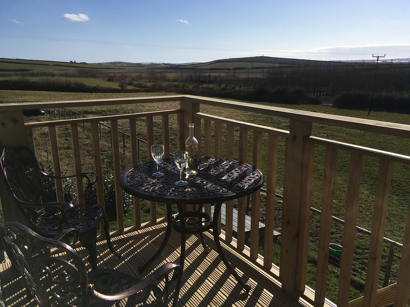 Enjoy the view of countryside and sea with a glass of your favourite tipple.