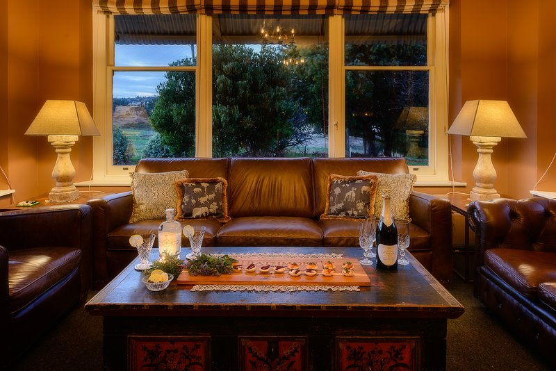country canapes by the fire with a glorious view of the Central Highlands