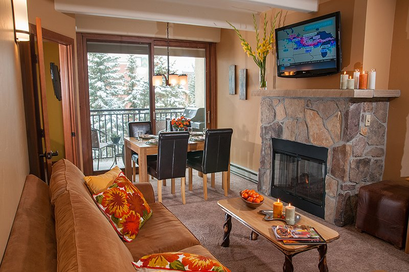 Living room with TV and gas fireplace.