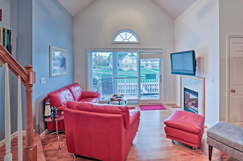 Relax on the soft leather couches in front of the flat-screen cable TV.