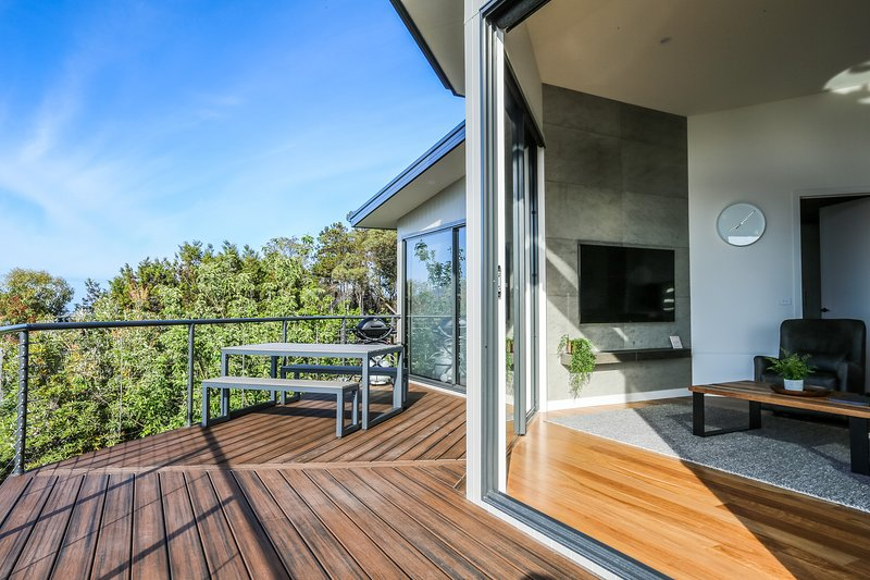Spacious Deck with seating and BBQ.