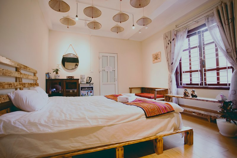 Bedroom with king-size bed and large windows