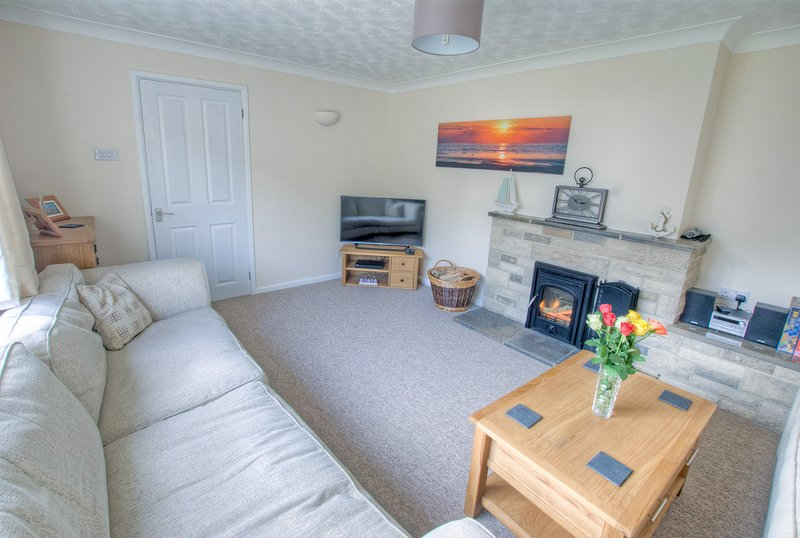 Lounge with wood burner, (starter basket of logs provided), TV with built in DVD. Radio.