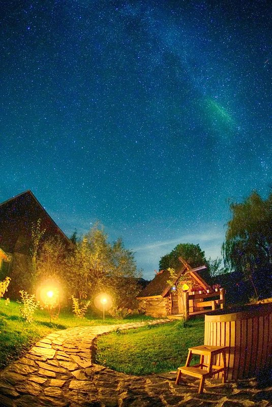 Starry sky above the garden spa with sauna, hot tub and plunge pool ...