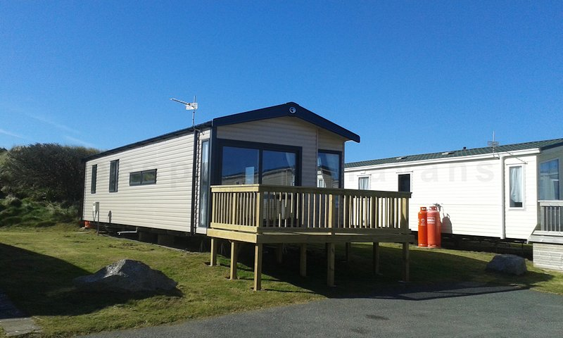 Brand new. No pets. Sleeps six. Two bedrooms. Two showers. Two WCs. Partial sea view side of deck.