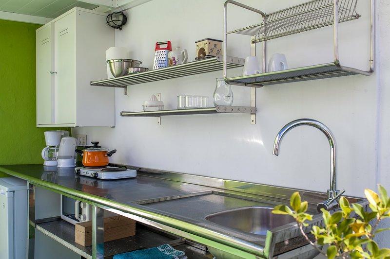 La cuisine porte sur la terrasse
