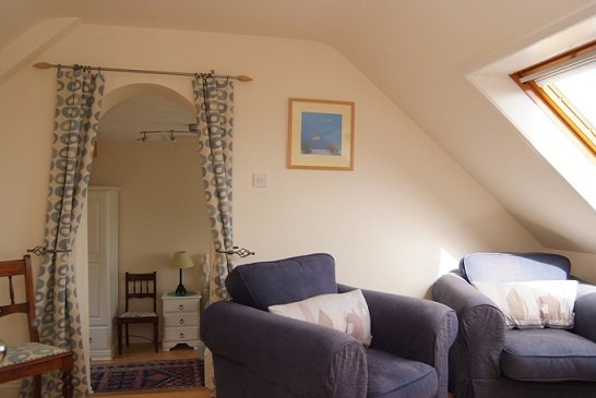 The upstairs sitting area leading to the twin bedroom.
