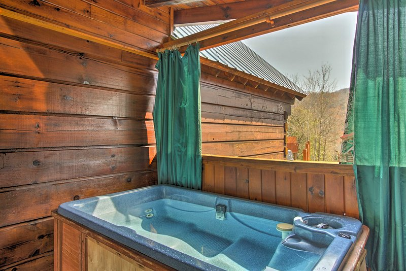 Two travelers will love relaxing in this private hot tub on the deck.