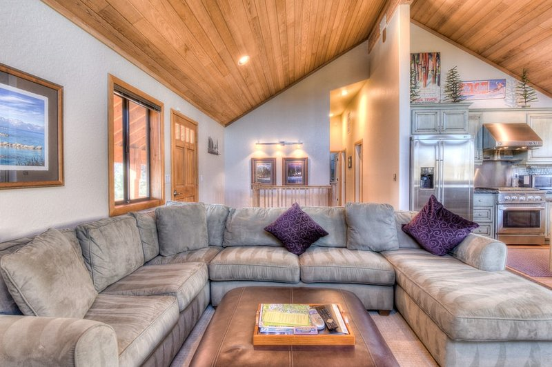 High, vaulted ceilings provide very spacious living and kitchen areas