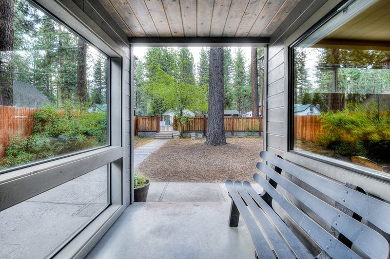 Front walkway with beautiful wood and glass finish