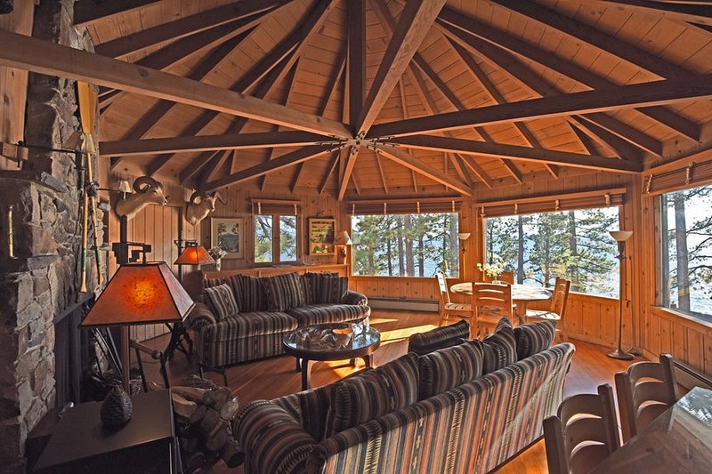 The living room features incredible 180 degree views of Lake Tahoe