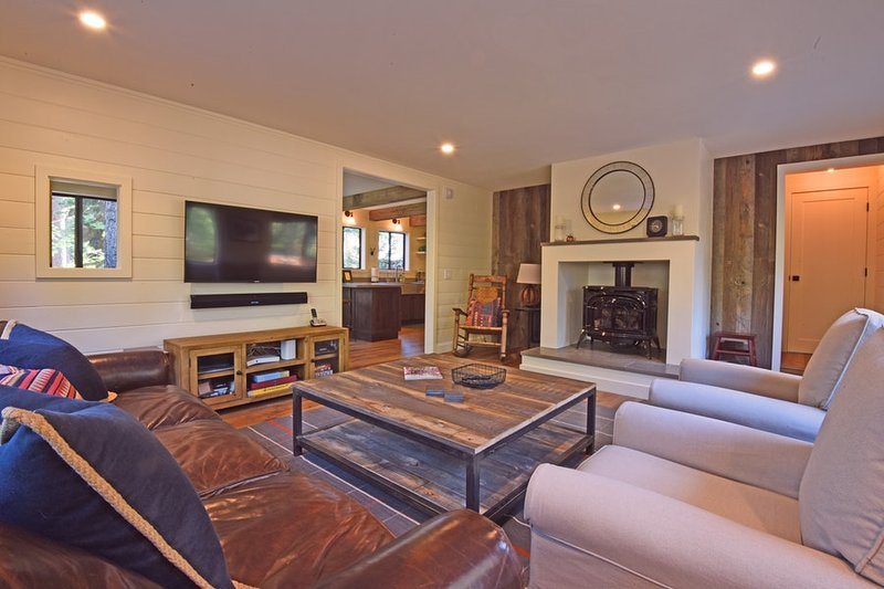 Living room, with a large flatscreen TV and gas burning stove