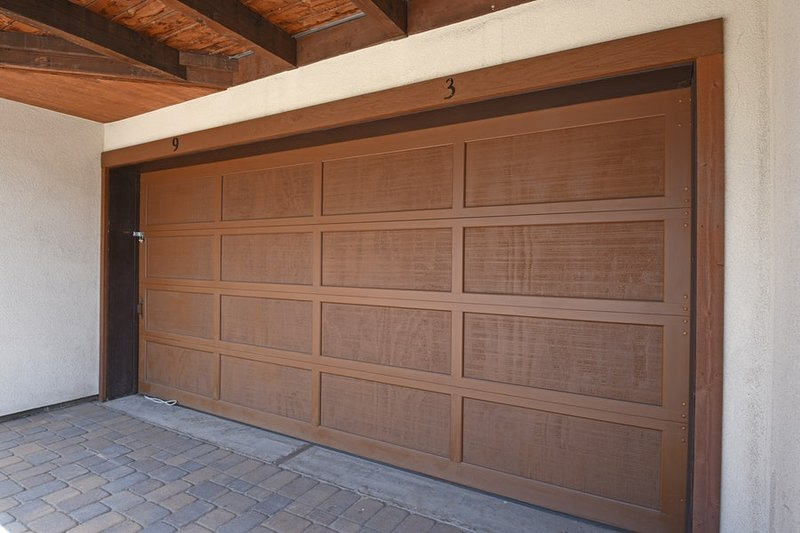 Garage for covered parking of a medium to small vehicle