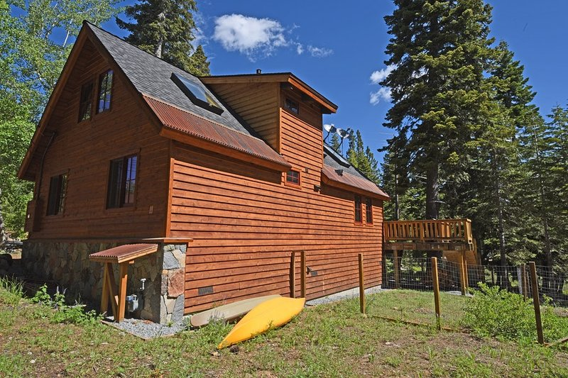 Side of the home, two kayaks for guest use